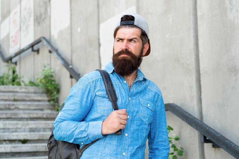 Fuel your soul with travel. Confident man walk street. Male barber care. brutal hipster with travel backpack. hiking. Adventure concept. urban style. Mature stock images