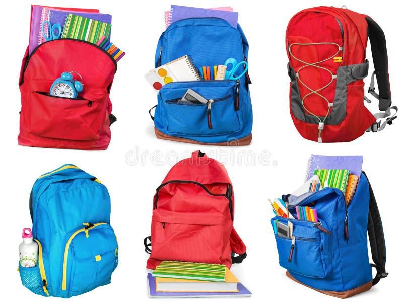 Fuentes de escuela coloridas en la mochila, collage encendido fotografía de archivo libre de regalías