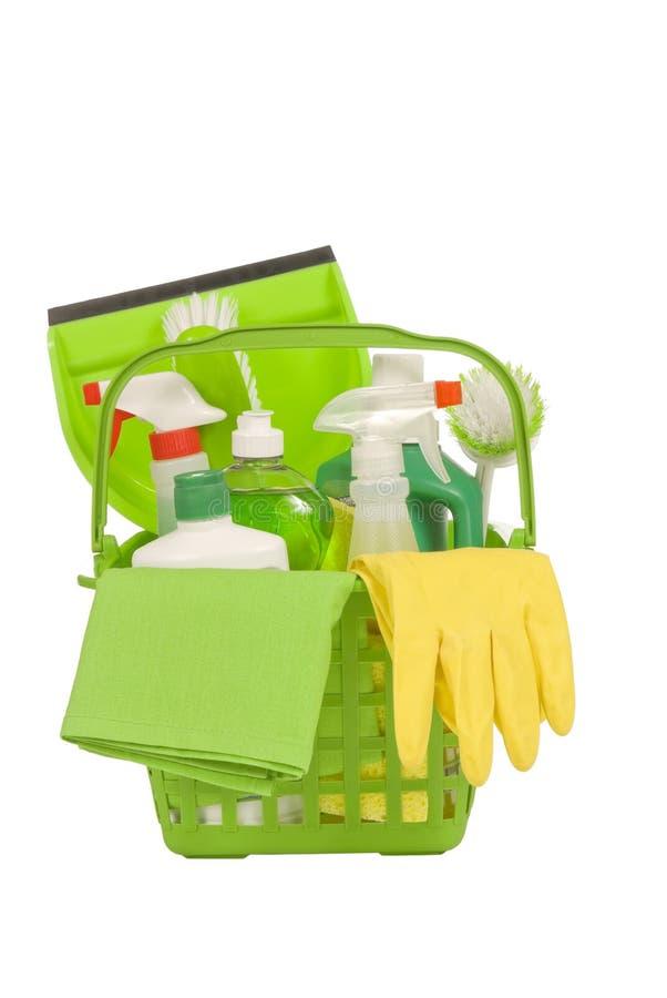 Fuentes de limpieza verdes con los guantes de goma fotos de archivo