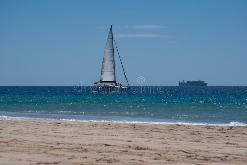 Fuerteventura, sailboat and ferryboat. stock photos