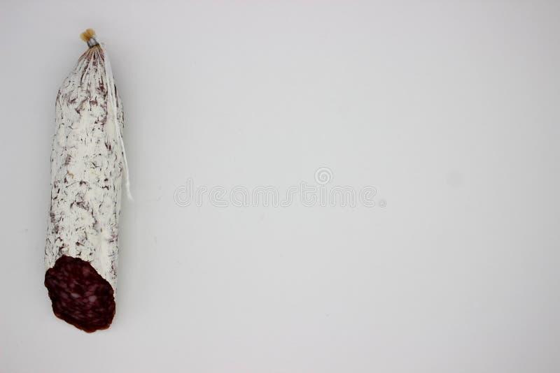 Fuet ? curada fina, seca Catalan, salsicha da carne de carne de porco em um intestino da carne de porco foto de stock