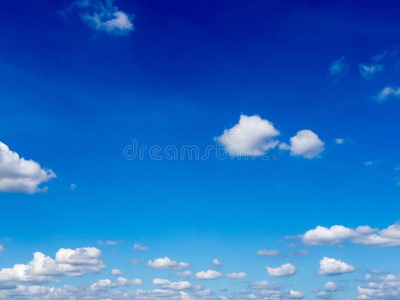 Blue sky background with clouds. Fuffy clouds on bright blue sky background,air royalty free stock photography