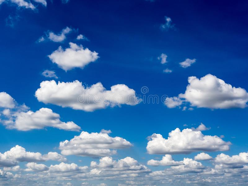 Blue sky background with clouds. Fuffy clouds on bright blue sky background,air royalty free stock images