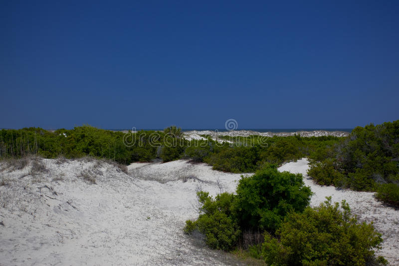 A fuga à praia fotografia de stock