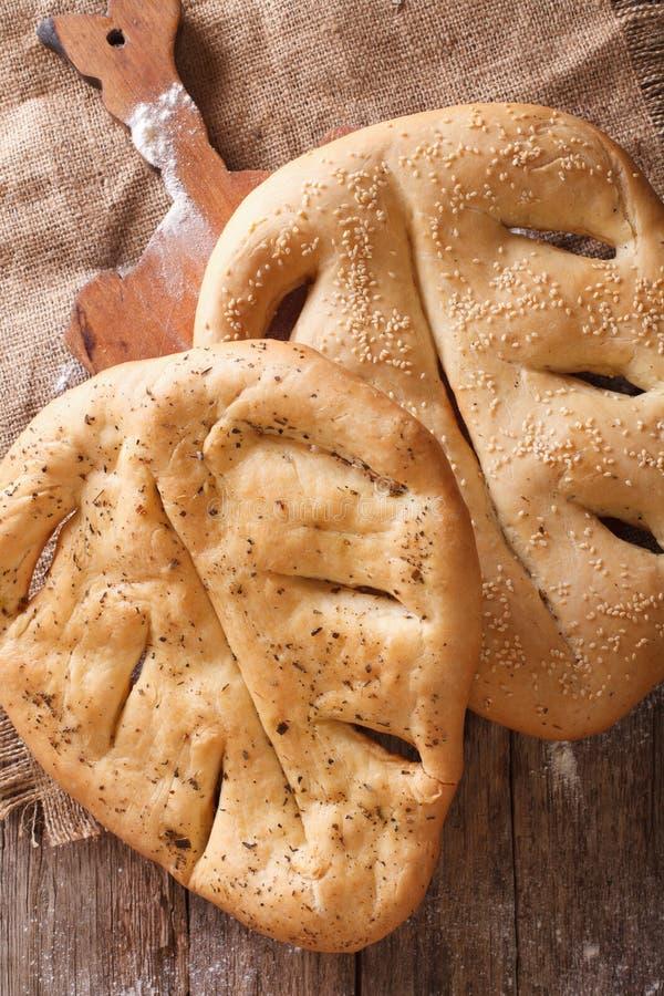 Fugasse franskbröd med closeupen för sesamfrö och ört Vertic fotografering för bildbyråer