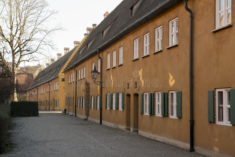 Fuggerei in Augsburg. The Fuggerai, world's oldest social housing complex in Augsburg, Bavaria stock images
