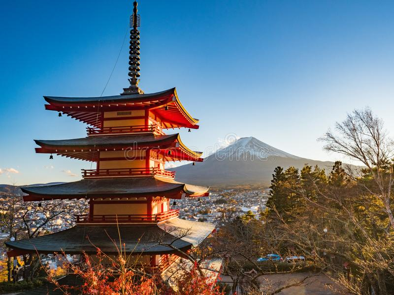 Fuji mountain with red pagoda in foreground. stock images
