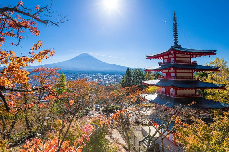 Fuji volcano mountain landscape in autumn in the most beautiful view. In Japan with sky cloud, temple, mountain, and Autumn leaf color by Fall Foliage stock photos