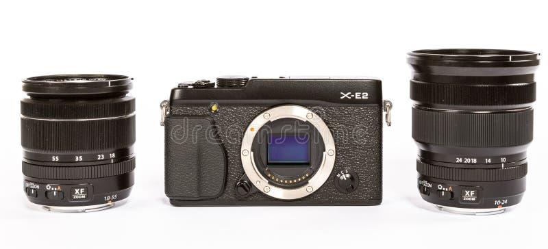 FUJIFILM X-E2 mirrorless camera with FUJINON LENS XF18-55mm F2.8-4 AND 10-24mm F4. Photo of FUJIFILM X-E2 mirrorless camera with FUJINON LENS XF18-55mm F2.8-4 stock photo