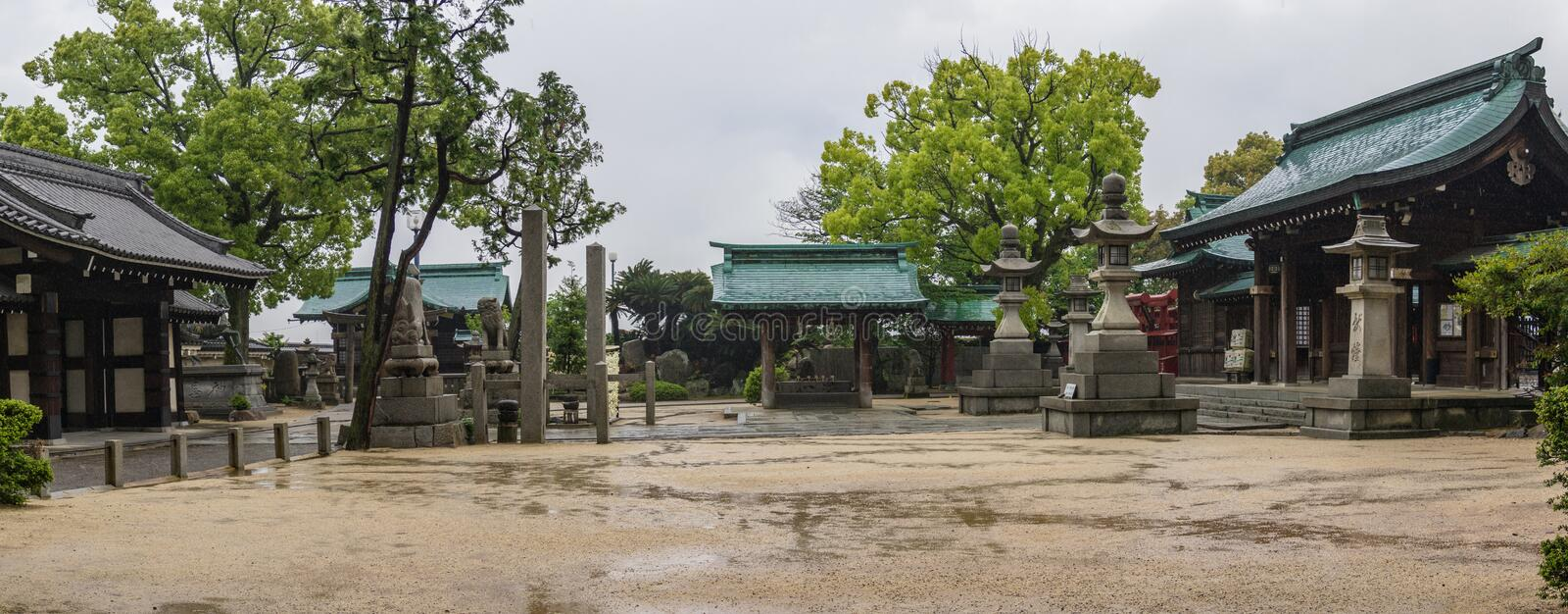 Panorama of Buildings and Landscape of japanese Buddhist Fukiage Shrine during a rainy day. Imabari, Ehime Prefecture, Japan. Asia royalty free stock photography