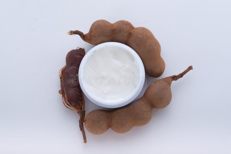 Fuktighetsbevarande hudkräm utdragen från tamarindfrukt arkivfoton