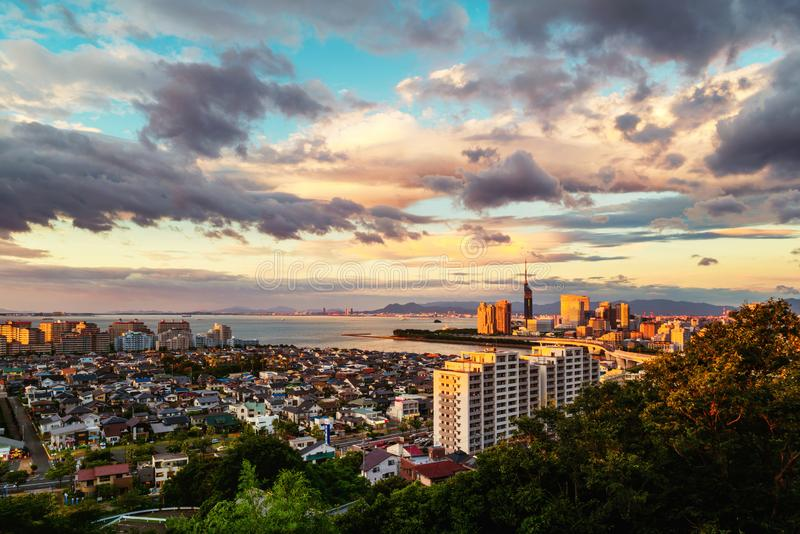 A sunset with a view of central Fukuoka, Japan, with tall modern buildings royalty free stock photos