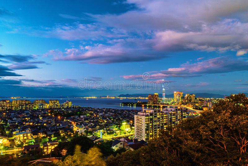 A sunset with a view of central Fukuoka, Japan, with tall modern buildings stock images