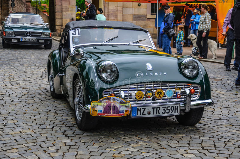 FULDA, GERMANY - MAI 2013: Triumph TR3 sports cabrio roadster re. Tro car on Mai 9, 2013 in Fulda, Germany stock images