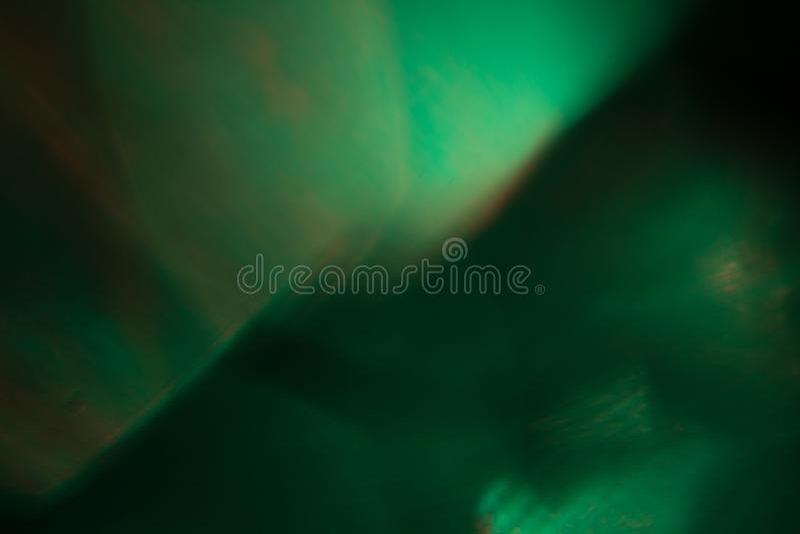 Fulgor da luz do sumário do alargamento da lente flash abstrato ótico borrão defocused macio Fundo verde, textura foto de stock