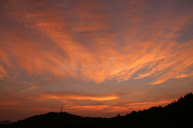 Fulgor de noite do por do sol foto de stock royalty free