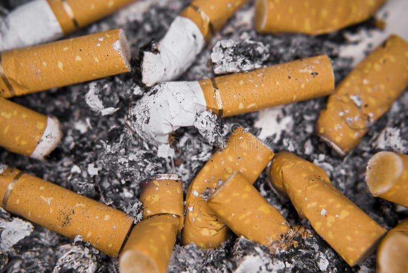 Full Ashtray. Ashtray full of spent cigarette butts stock photography