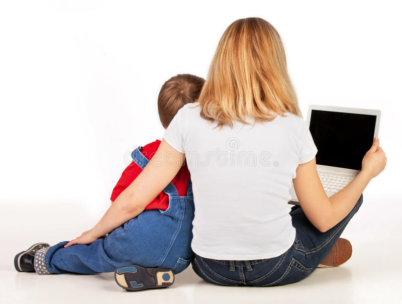 Full-back position with laptop. Mother and son sitting on the floor full-back position with laptop on white background stock image