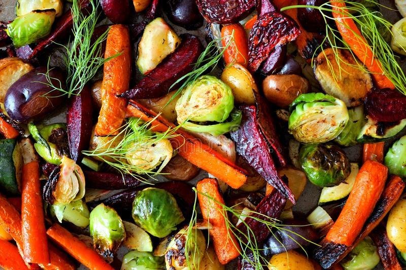 Full background of roasted autumn vegetables stock images