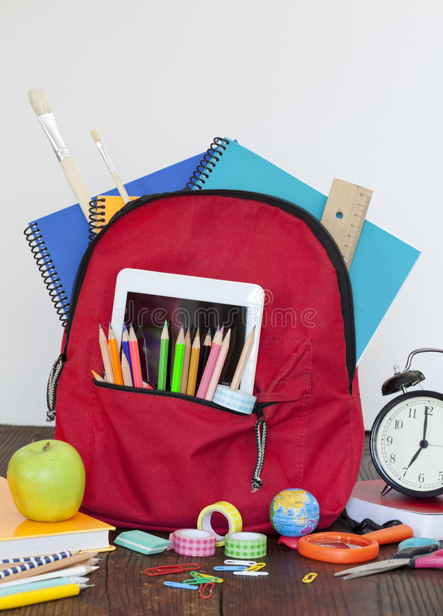 Full of bag school supplies royalty free stock photo