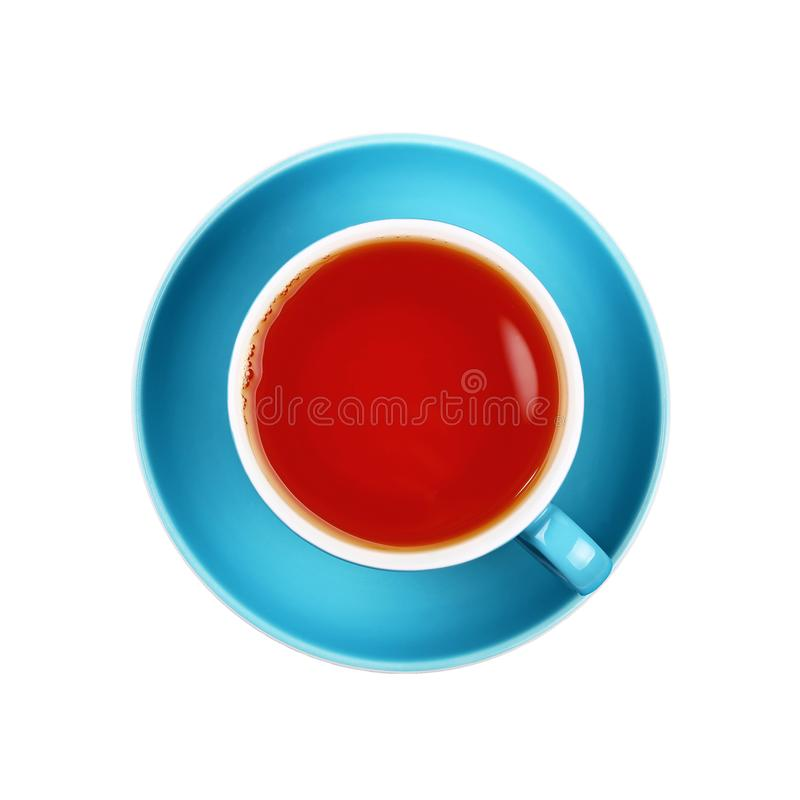 Full black tea in blue cup close up isolated royalty free stock photos