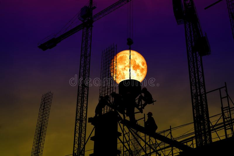 full blood moon back silhouette worker on construction royalty free stock images
