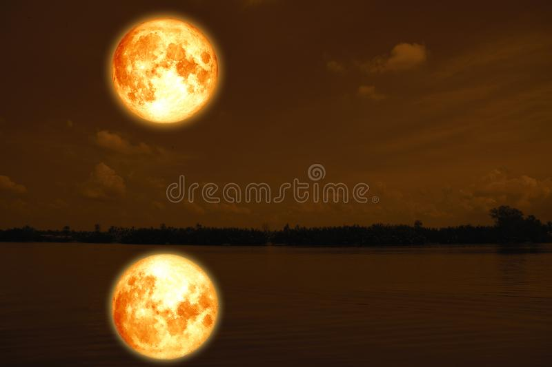 full blood moon on sea and ocean light sky silhouette cloud stock photography