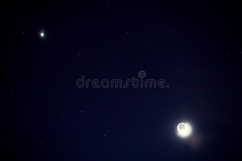 Full blue moon with star at dark night sky background.  royalty free stock photos