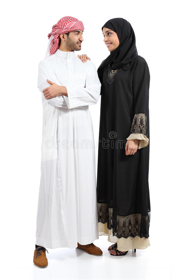Full body of an arab saudi couple posing together. Isolated on a white background royalty free stock image