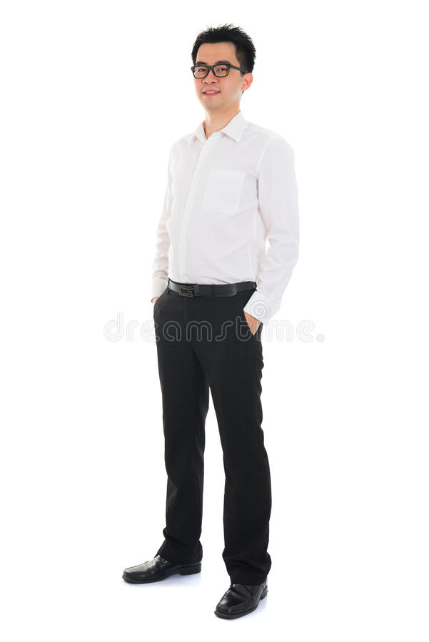 Full body Asian business man standing over white background royalty free stock images