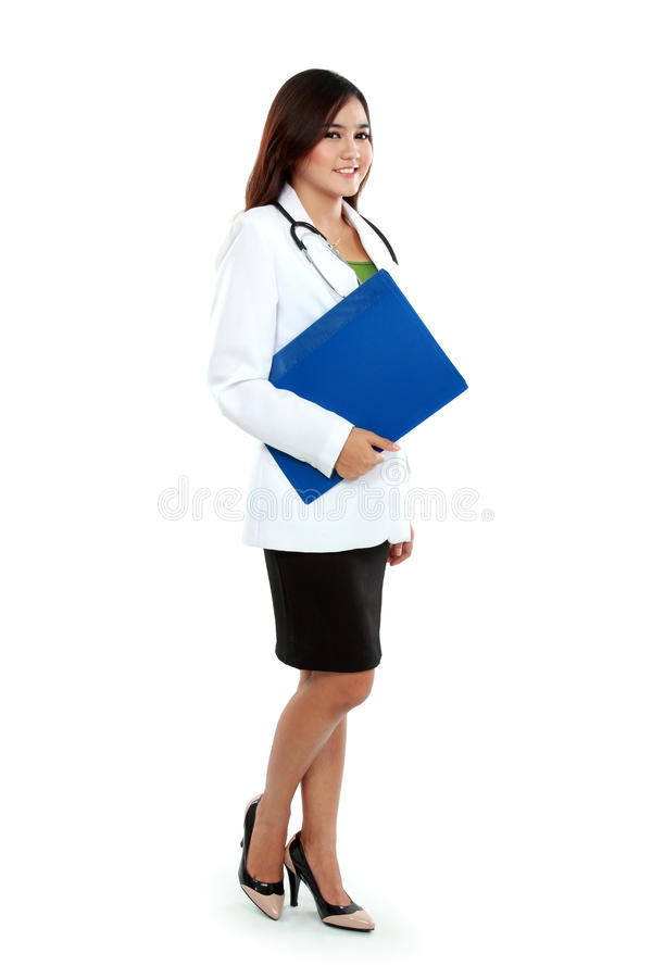 Full body asian female medical doctor holding a clipboard standing royalty free stock photos