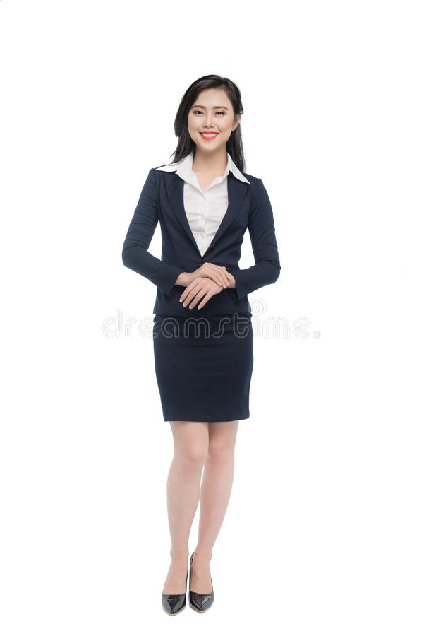 Full body of an attractive young businesswoman isolated on white.  stock photography