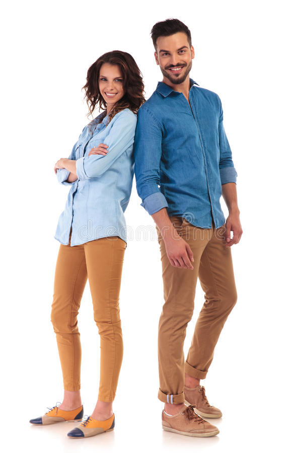 Full body of a casual couple smiling royalty free stock photo