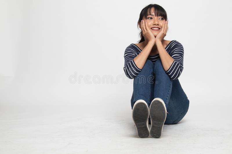 Full body of  beautiful young Asian woman  sit on floor. On white background royalty free stock image
