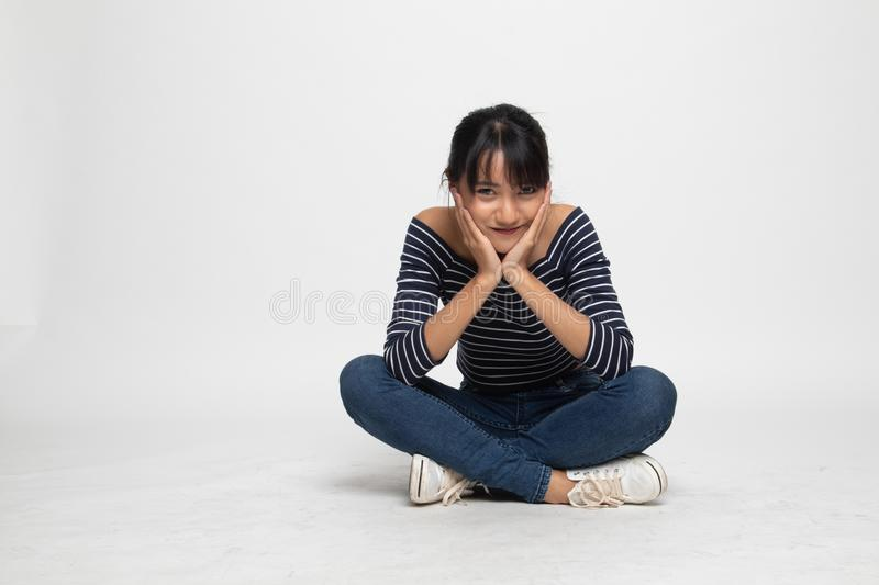 Full body of  beautiful young Asian woman  sit on floor. On white background royalty free stock images