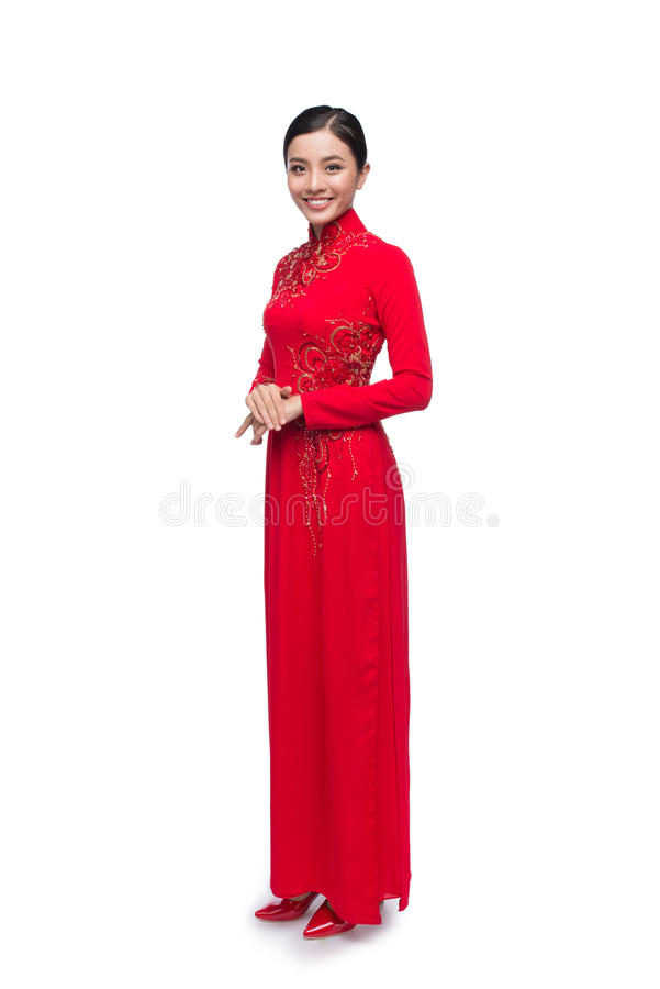 Full body of charming Vietnamese Woman in Ao Dai Traditional Dress isolated on white. royalty free stock photos