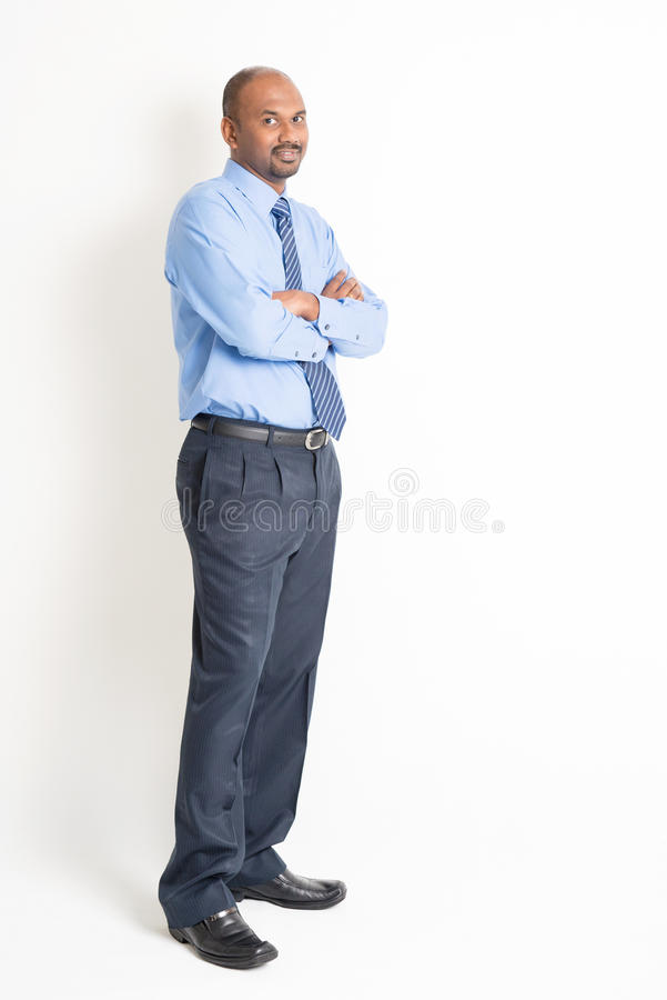 Full body confident mature Indian man executive stock images