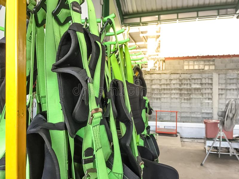 Full body harness hanging on the rack,personal protective equipment for  height work.  stock photography