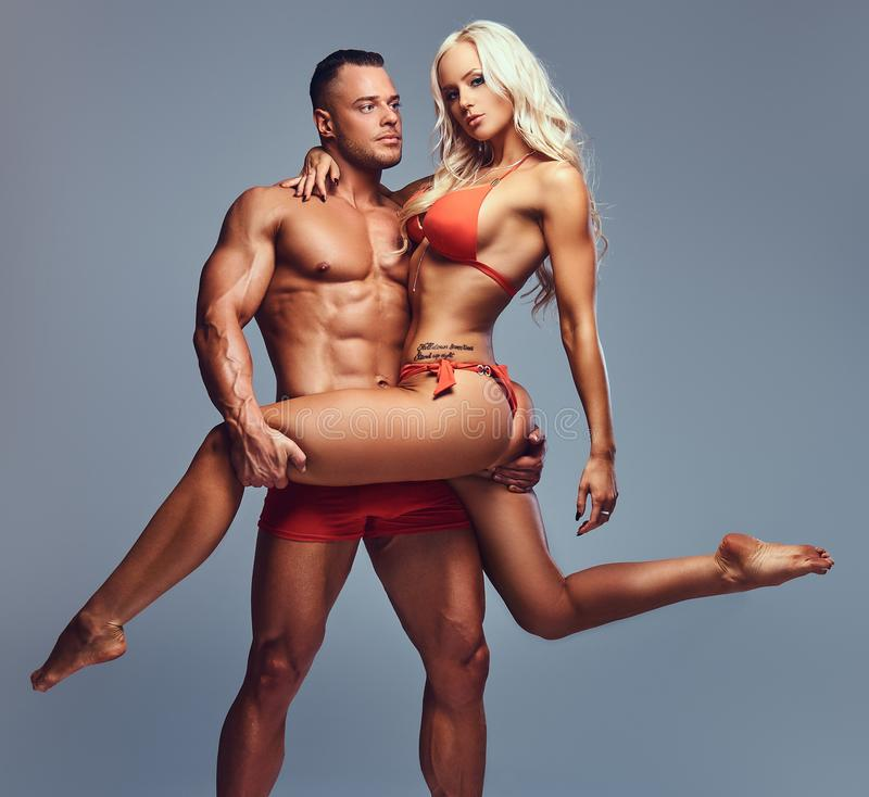Full body image of attractive fitness couple. stock image