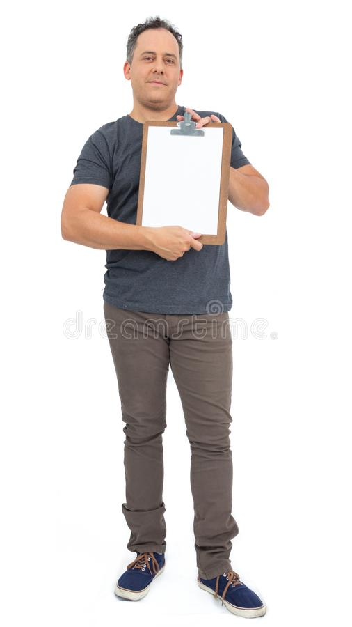 Full body image of man holding a clipboard. He is bald, has over. Smiling man is showing a clipboard. Full body image. He is bald, has overweight and wears dark stock image