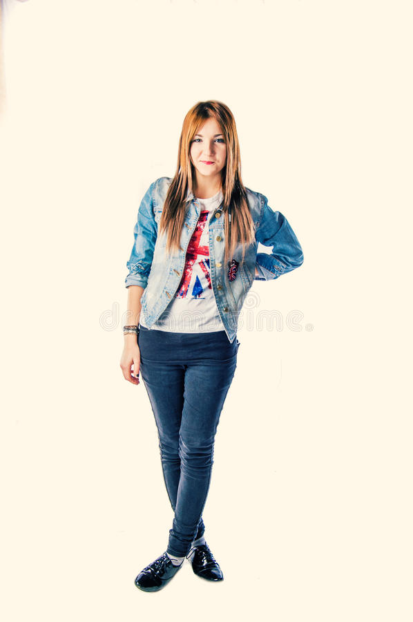 Full body image of a modern girl. In jeans jacket royalty free stock image