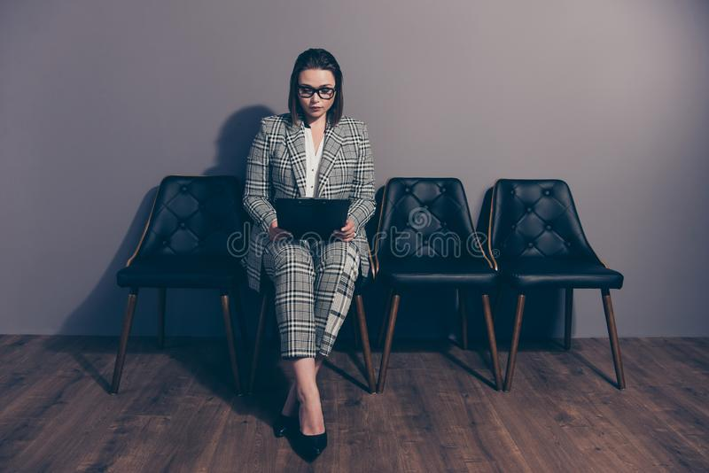 Full body length size photo portrait of serious concentrated focused smart clever intelligent she her lady using holding stock images