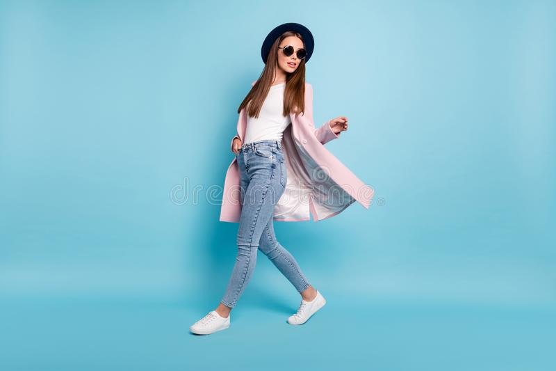 Full body photo of attractive lady in eyewear eyeglasses walking having promenade free time wearing season coat denim. Full body photo of attractive lady in royalty free stock image
