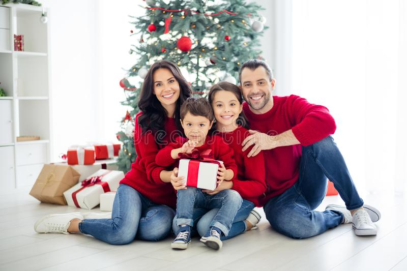 Full body photo of big full charming dad mom schoolgirl small boy holding package for christmas night enjoy x-mas having royalty free stock images