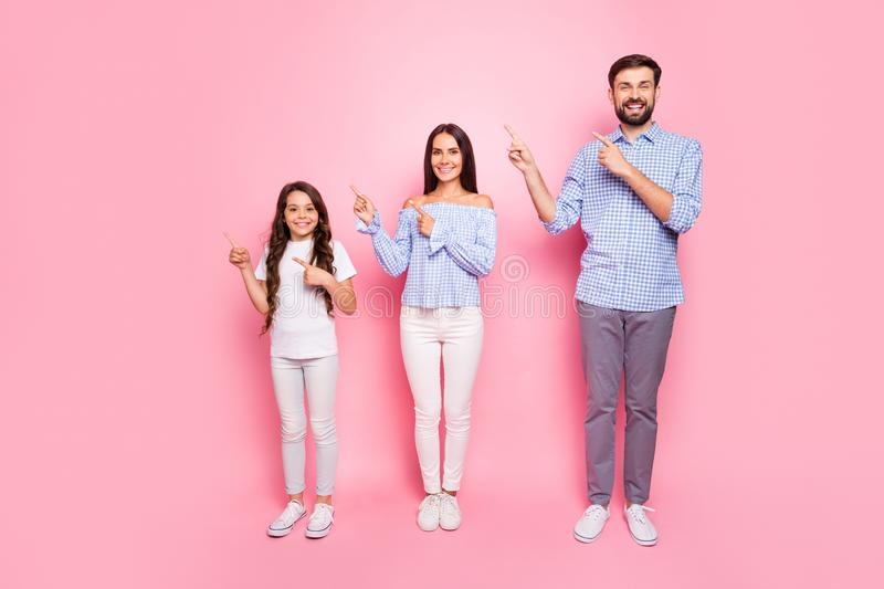 Full body photo of charming family with long wavy curly haircut pointing at copy space wearing checkered shirt trousers stock photos