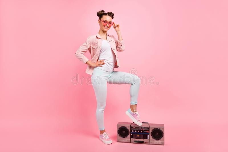 Full body photo of charming youth touching her modern eyewear eyeglasses wearing white pants trousers isolated over pink. Full body photo of charming youth royalty free stock photos