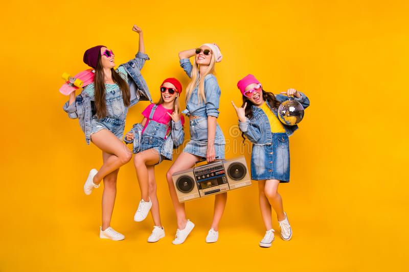 Full body photo of crazy carefree wearing street style denim outfit showing horned signs having fun entertainment using. Full body photo of crazy carefree royalty free stock image