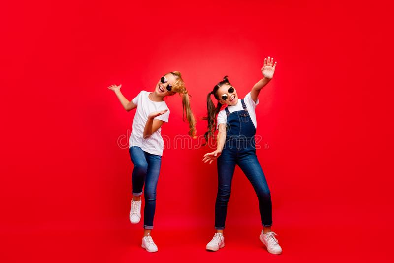 Full body photo of funky funny crazy two brown blonde hair girlfriends with tails fun weekends holidays dance scream. Full body photo of funky funny crazy two royalty free stock photography