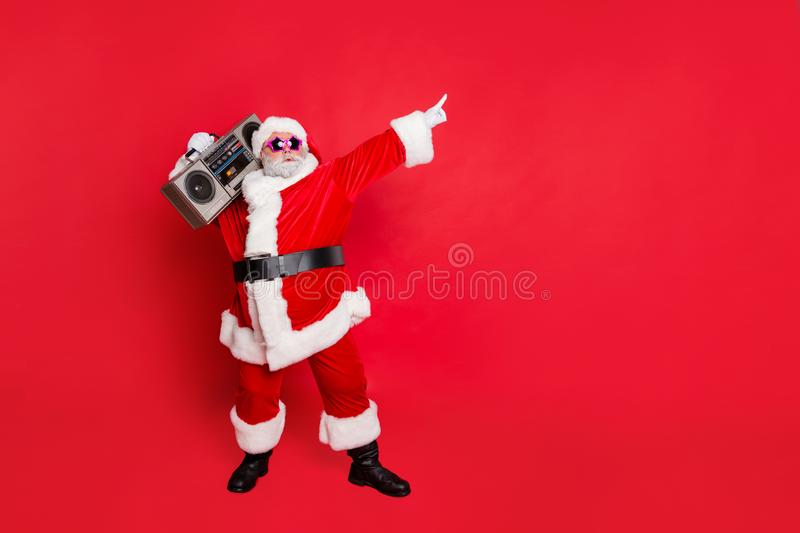 Full body photo of funny cute santa claus with sound boom disco box dancing wearing style eyeglasses eyewear headwear. Full body photo of funny cute santa claus royalty free stock photography