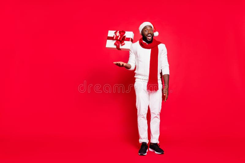 Full body photo of funny dark skin man offering cool x-mas prices throwing giftbox up air amazing proposition wear. Full body photo of funny dark skin man royalty free stock photos